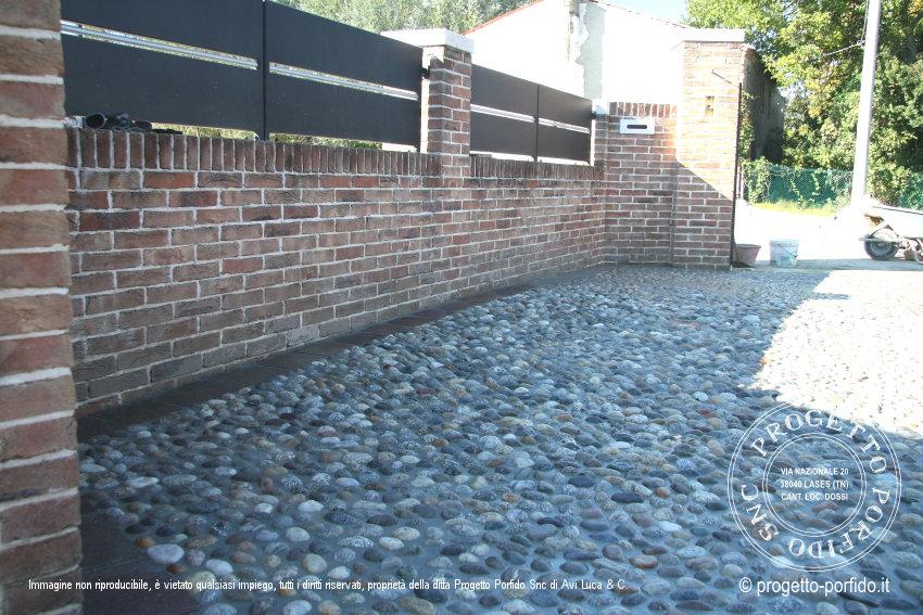 Foto pavimentazione con ciottoli di fiume progetto porfido snc